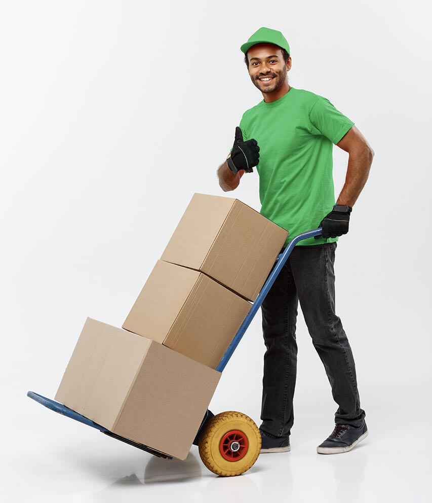 Man in green shirt giving a thumbs up sign as he assists in moving boxes