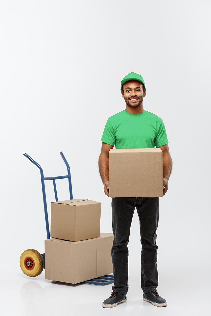 Man wearing a green shirt, holding a box